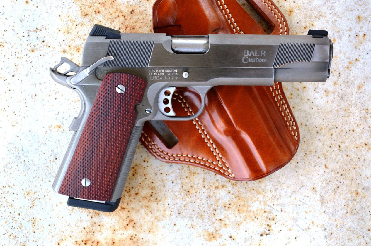 Les Baer Concept VI 1911 profile right atop a brown leather holster