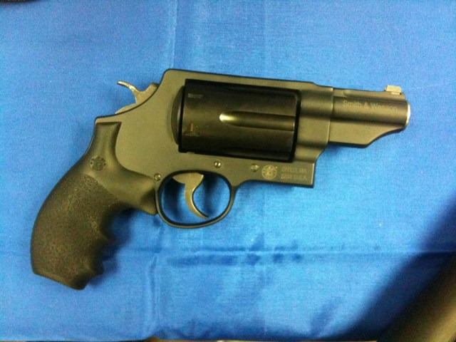 Smith and Wesson Governor revolver right profile on blue background