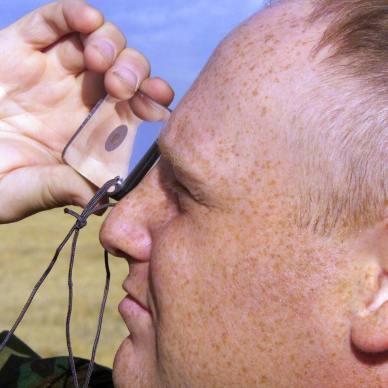 man using a signal mirror