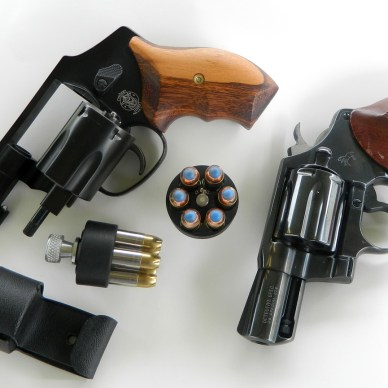 2 snubnose .38 revolvers with speed loaders