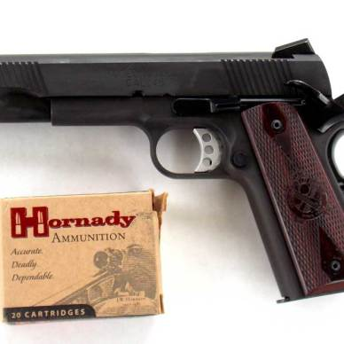 Springfield Loaded 1911 pistol and box of Hornady Critical Defense ammunition