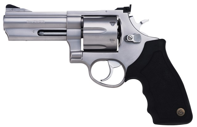 Taurus revolver with black grip and silver barrel pointed to the left on a white background.