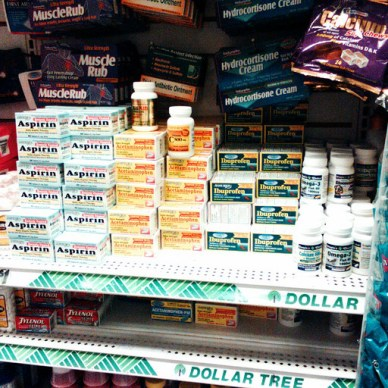 Picture shows a shelf full of medicine.
