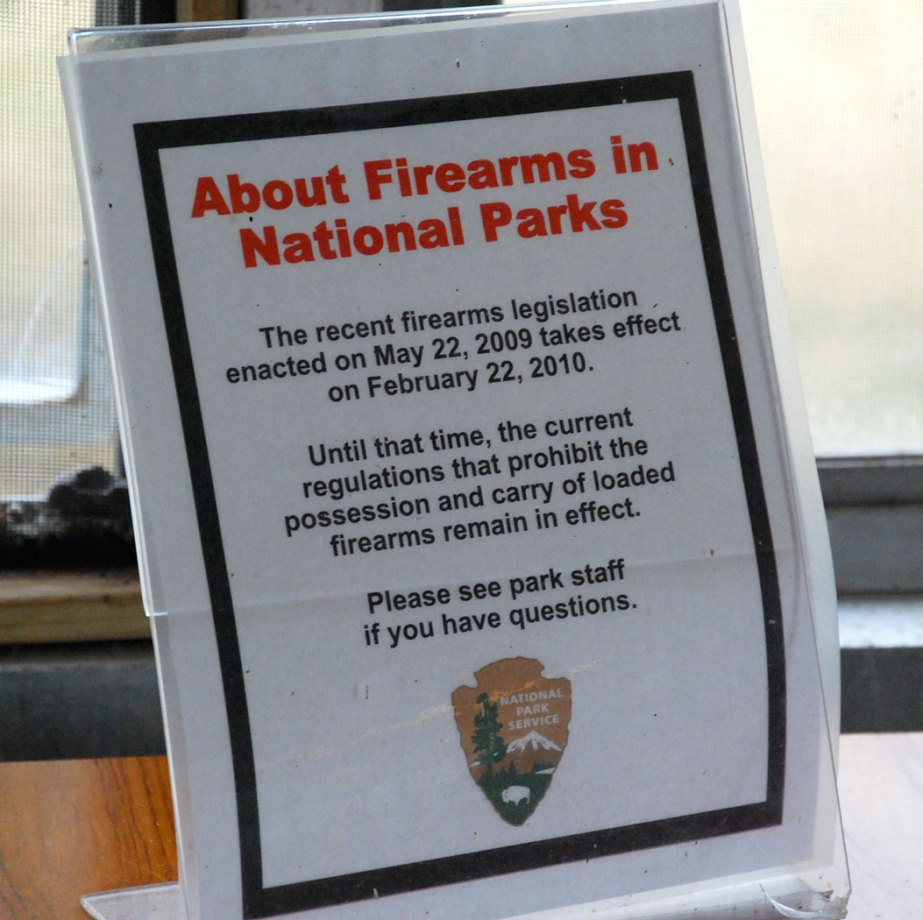 Picture shows a sign detailing the law allowing concealed carry in national parks.