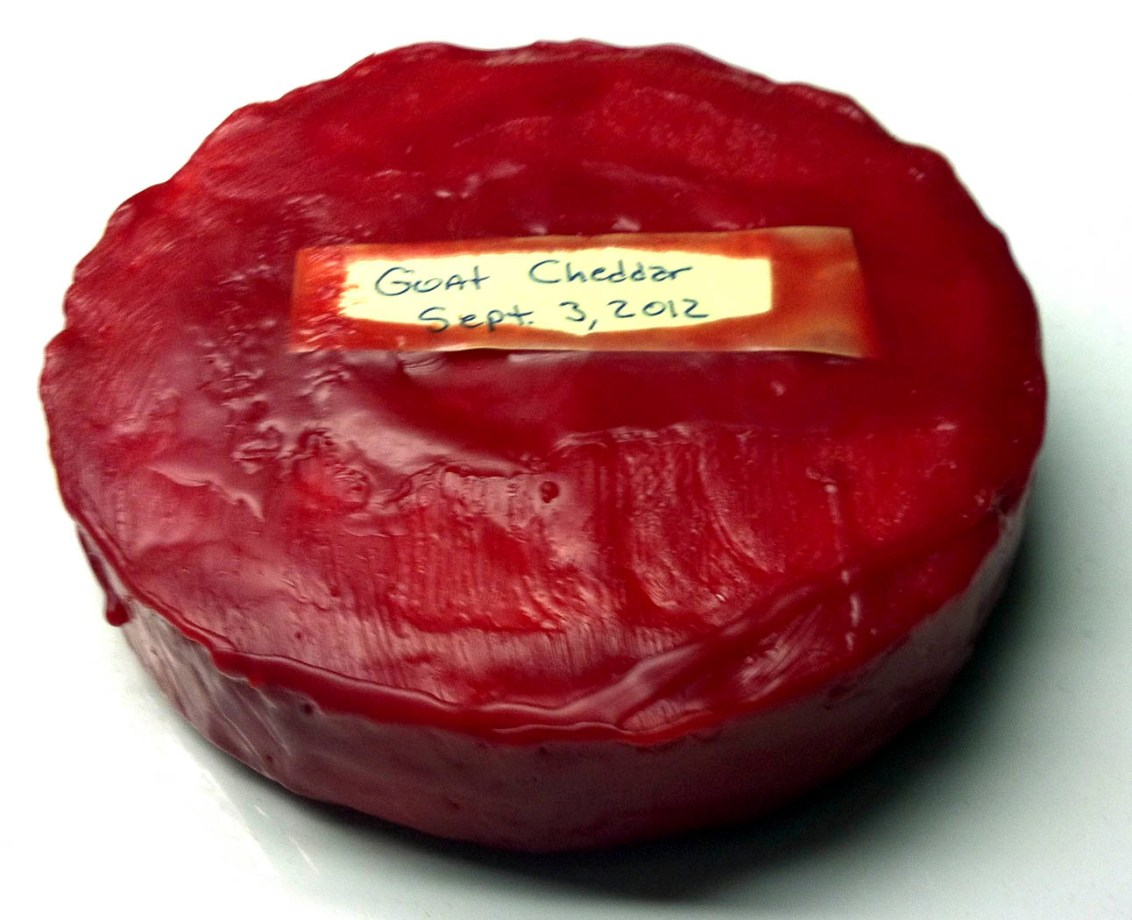 Waxed cheese round and label
