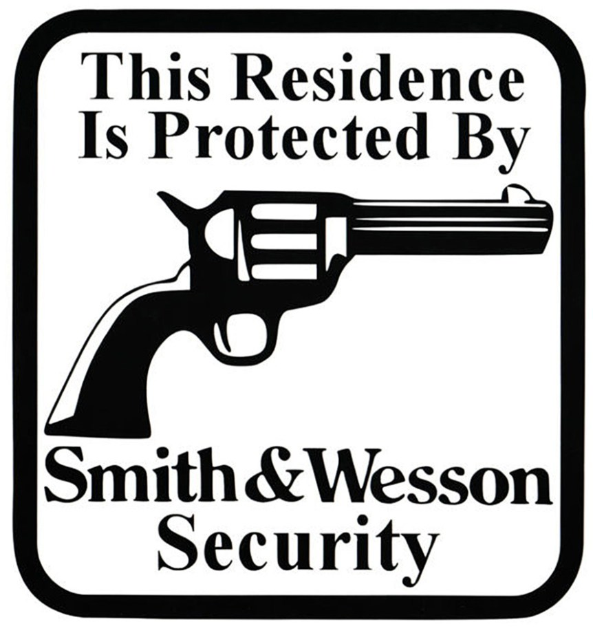 """Black and white sign with a revolver with """"this residence is protected by Smith and Wesson security"""