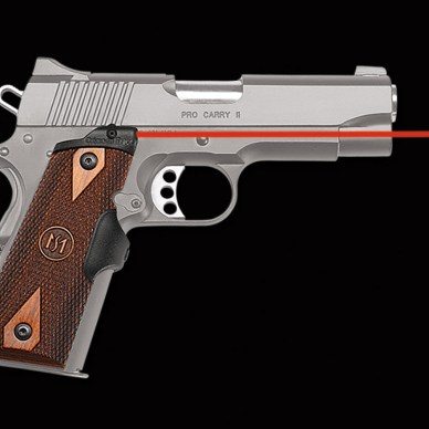 semiautomatic pistol with wood Crimson Trace lasergrips