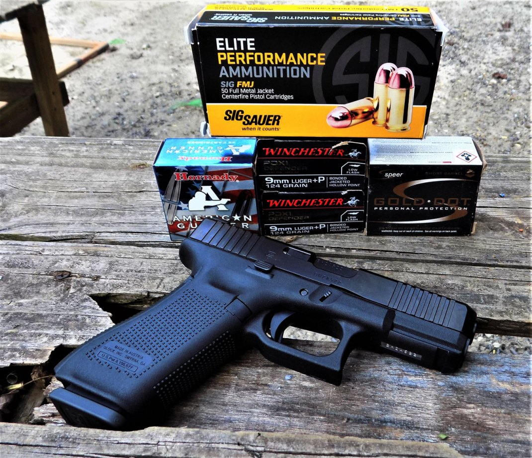 Glock G45 pistol with several boxes of ammunition