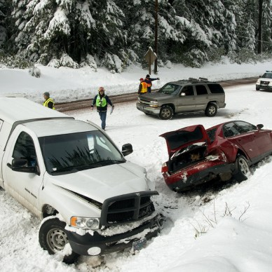 Two cars in the snow after an auto accident.