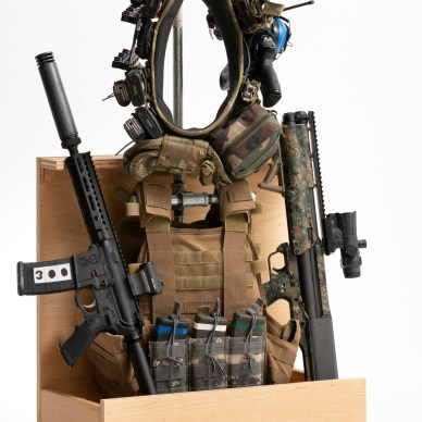 Gear tree with rifle, shotgun, plate carrier and gear belt