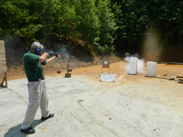 Bob Campbell shooting a 12 gauge shotgun at the shooting range