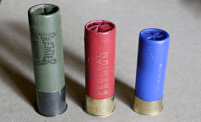 Three shotshells ranging from a 3-inch magnum to 2 3/4-inch in length