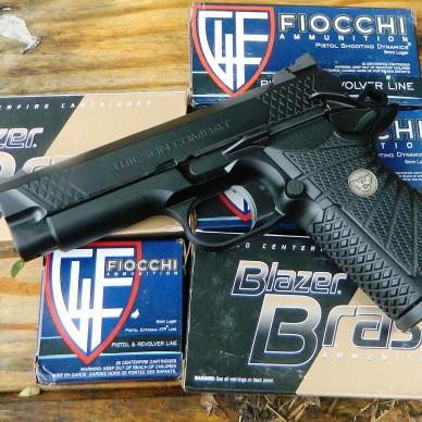 Wilson Combat 9mm 1911 pistol atop several boxes of Fiocchi ammunition