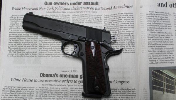 1911 pistol on top of newspaper