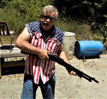 Bob Campbell holding a 12 gauge shotgun