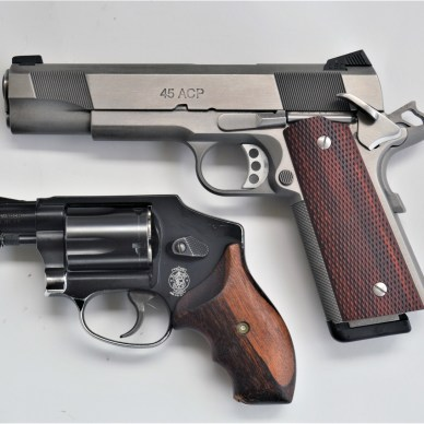 Colt 1911 pistol with a snubnose revolver