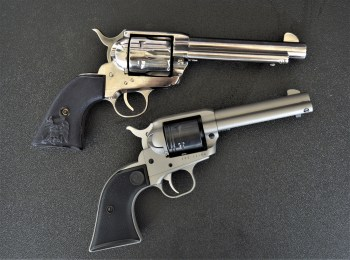 Two Single action Army revolvers