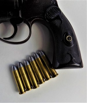 Pistol butt with several .32-20 cartridges ready for handloading