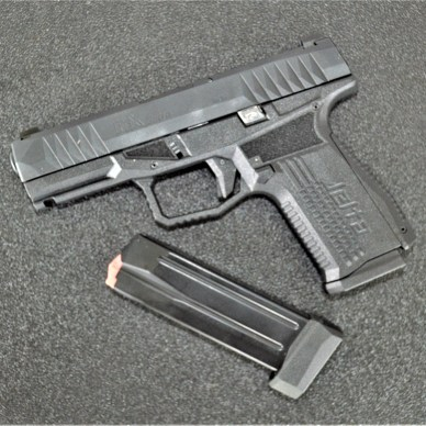 Arex Delta pistol left profile with extended magazine