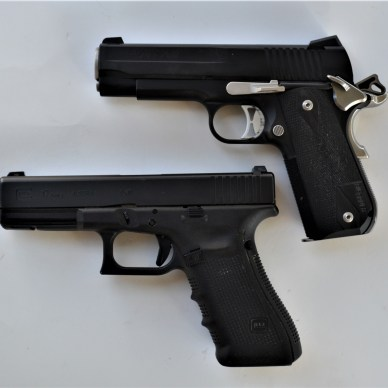 Hammer-fired and striker-fired handguns - side view