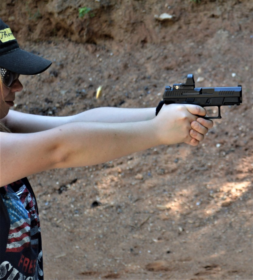 9mm female shooter in action