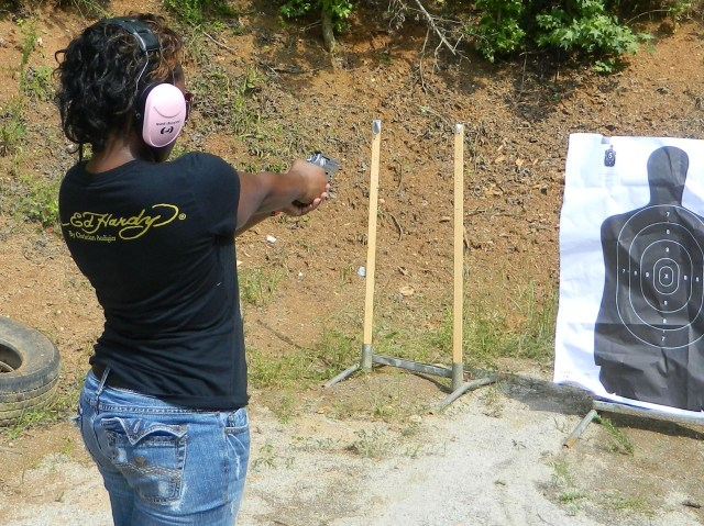 Former military female shooter at the range