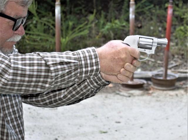 Man gripping j-frame revolver