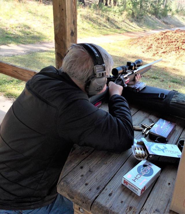 Man firing Savage Apex Storm Rifle