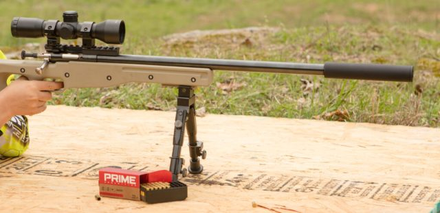 Boy shooting cricket precision rifle on bipod