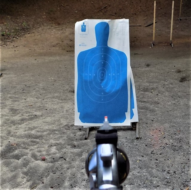Revolver pointed at target