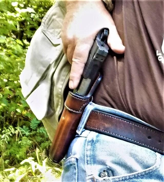 Drawing handgun from holster