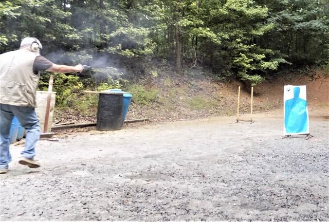 Man shooting handgun while moving