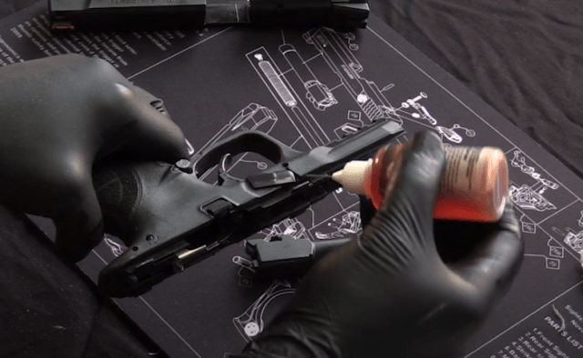 Applying oil to Smith and Wesson M&P handgun