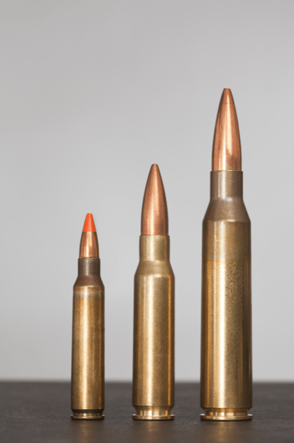three rifle cartridges increasing in size