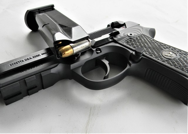 Beretta 92 pistol with magazine and 9mm Luger ammunition