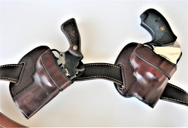 Gun Belt with Two Handguns in Holsters
