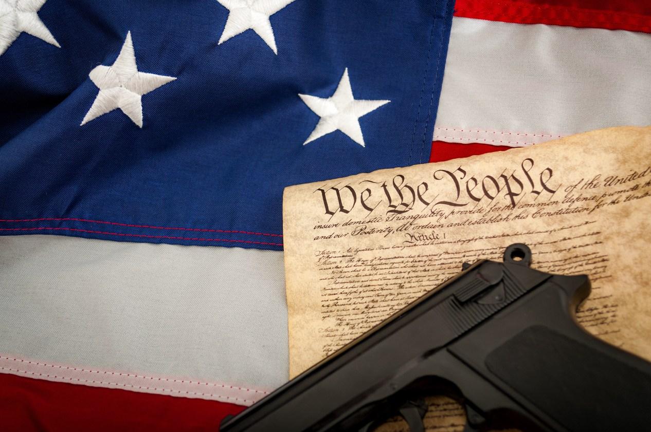 Gun on constitution on American flag California lawsuit