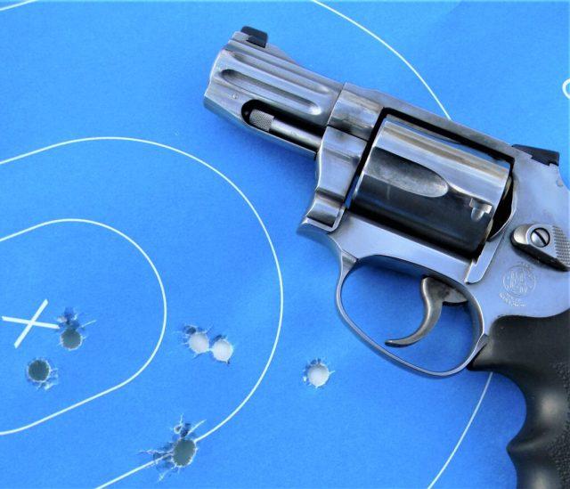 revolver on blue target