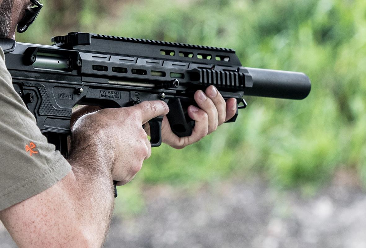 man shooting panzer arms bp-12 shotgun