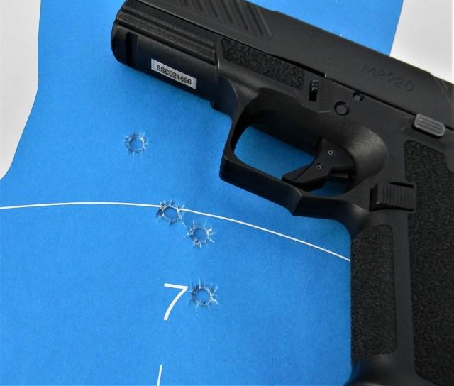 semi-auto handgun on blue target