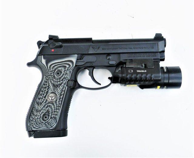 Beretta pistol with weapon light