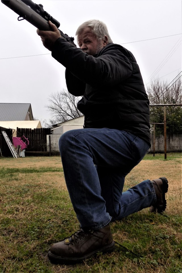 man kneeling firing rifle carbine marksmanship