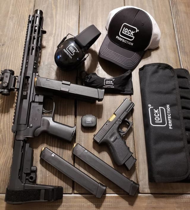 AR pistol and glock pistol with glock hat, hearing protection and mag carrier