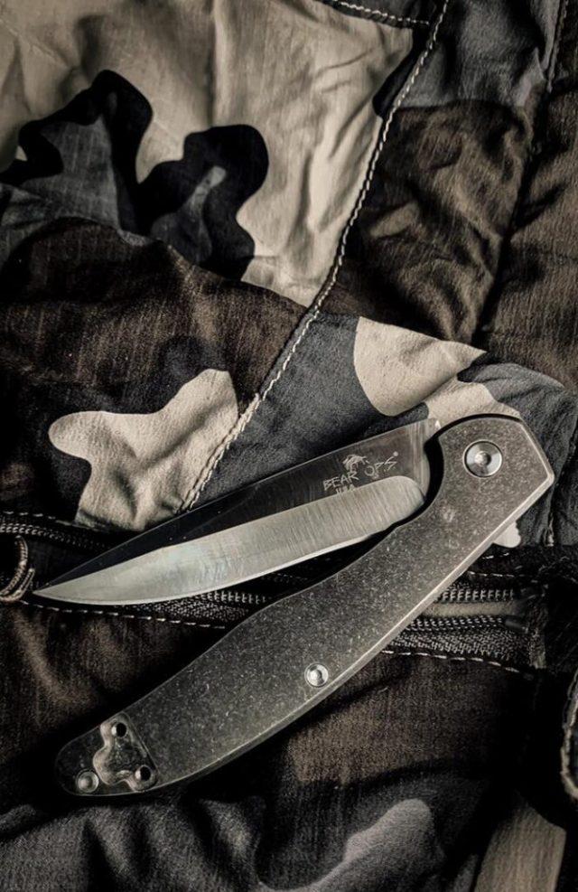 folding pocket knife on grey background
