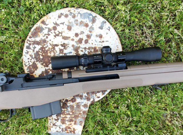 rifle with scope on steel target carbine marksmanship