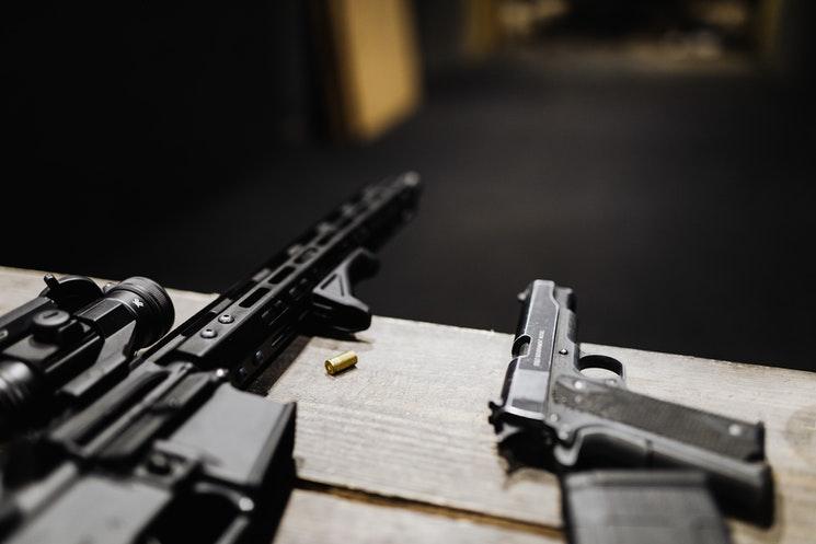 AR-15 and Handgun on range bench