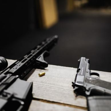AR-15 and Handgun on range bench