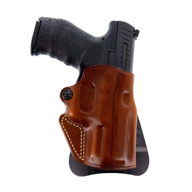 Pistol in brown leather holster