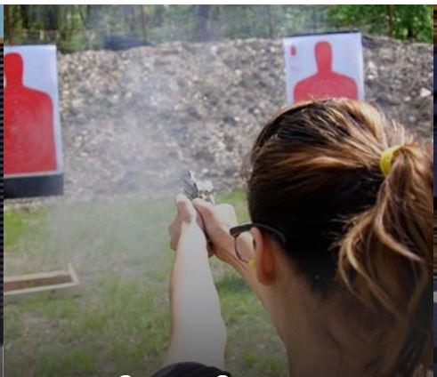 woman firing pistol at target