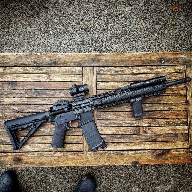 AR-15 rifle on wood bench